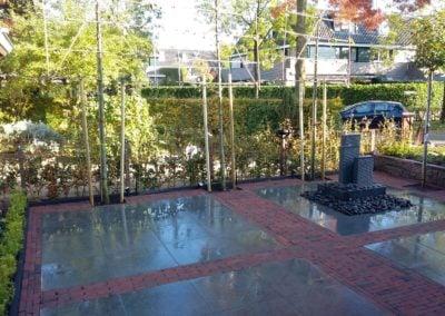 Tuinaanleg.com hoveniersbedrijf keramische tegels terras in Huizen