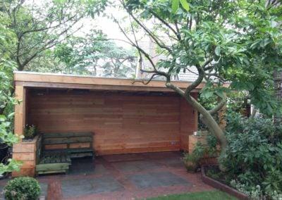 Tuinaanleg.com hoveniersbedrijf overkapping met terrasverwarming in Bussum